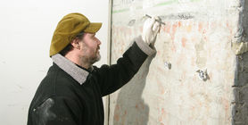 Conservator Wulf Stehr examining traces of old paint