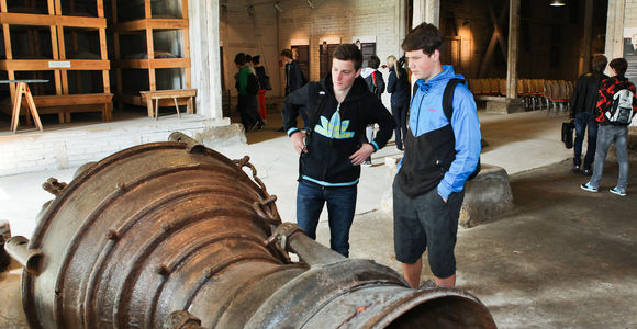 Students examining an A4 rocket engine