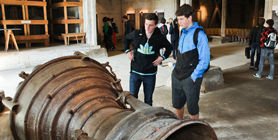 Students examining a rocket engine in the memorial